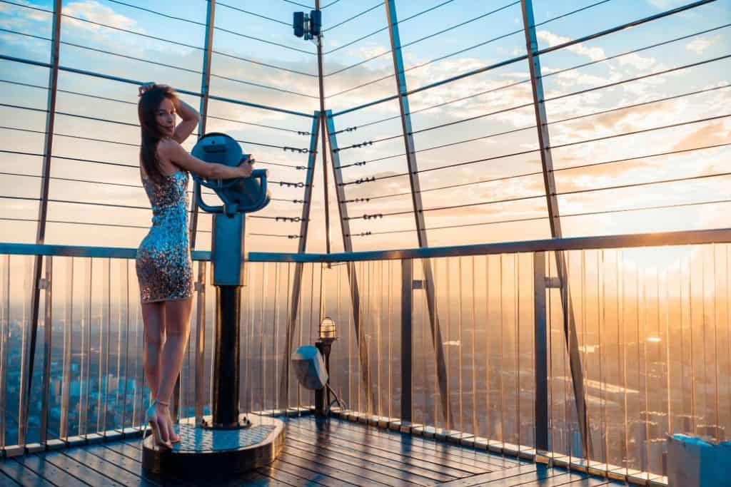 Girl using Telescope For Watching