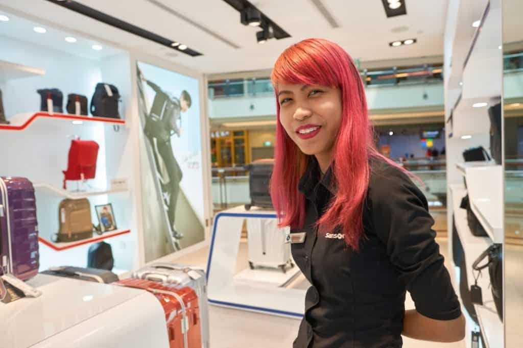 girl in a samsonite showroom