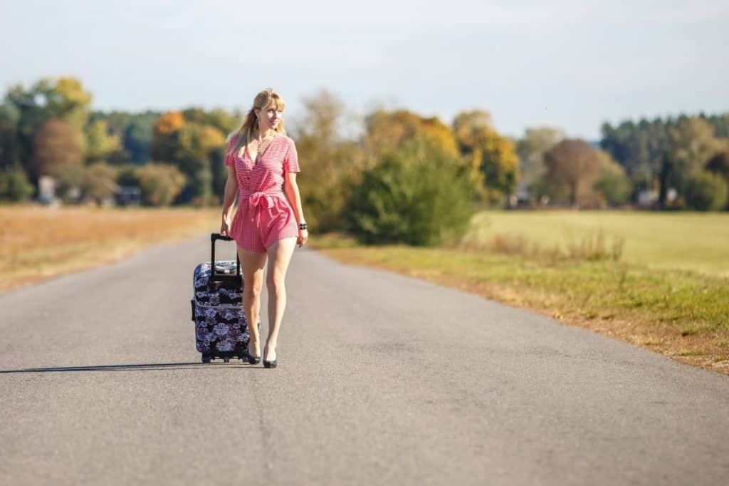 skyways model suitcase dragged by a woman