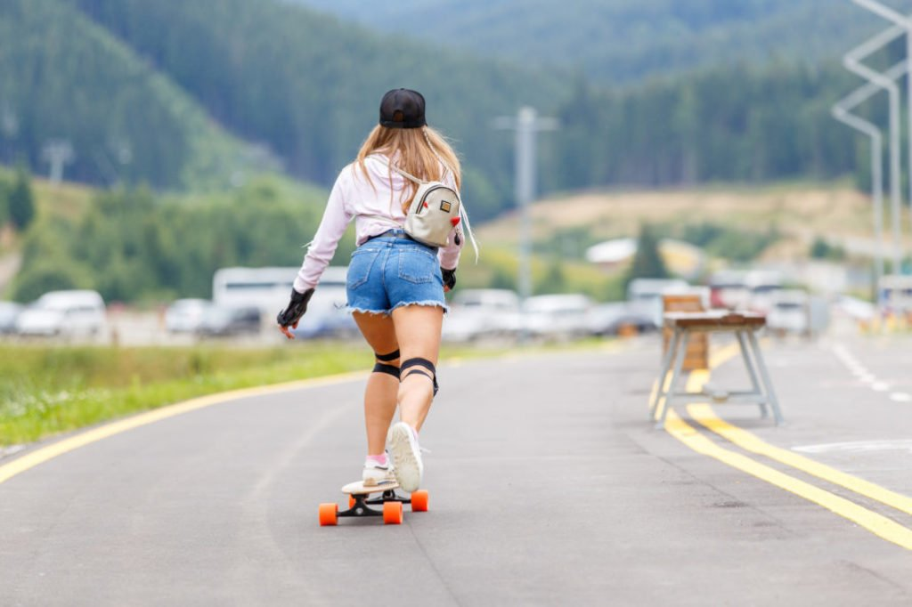 Riding A Street Surf Longboard